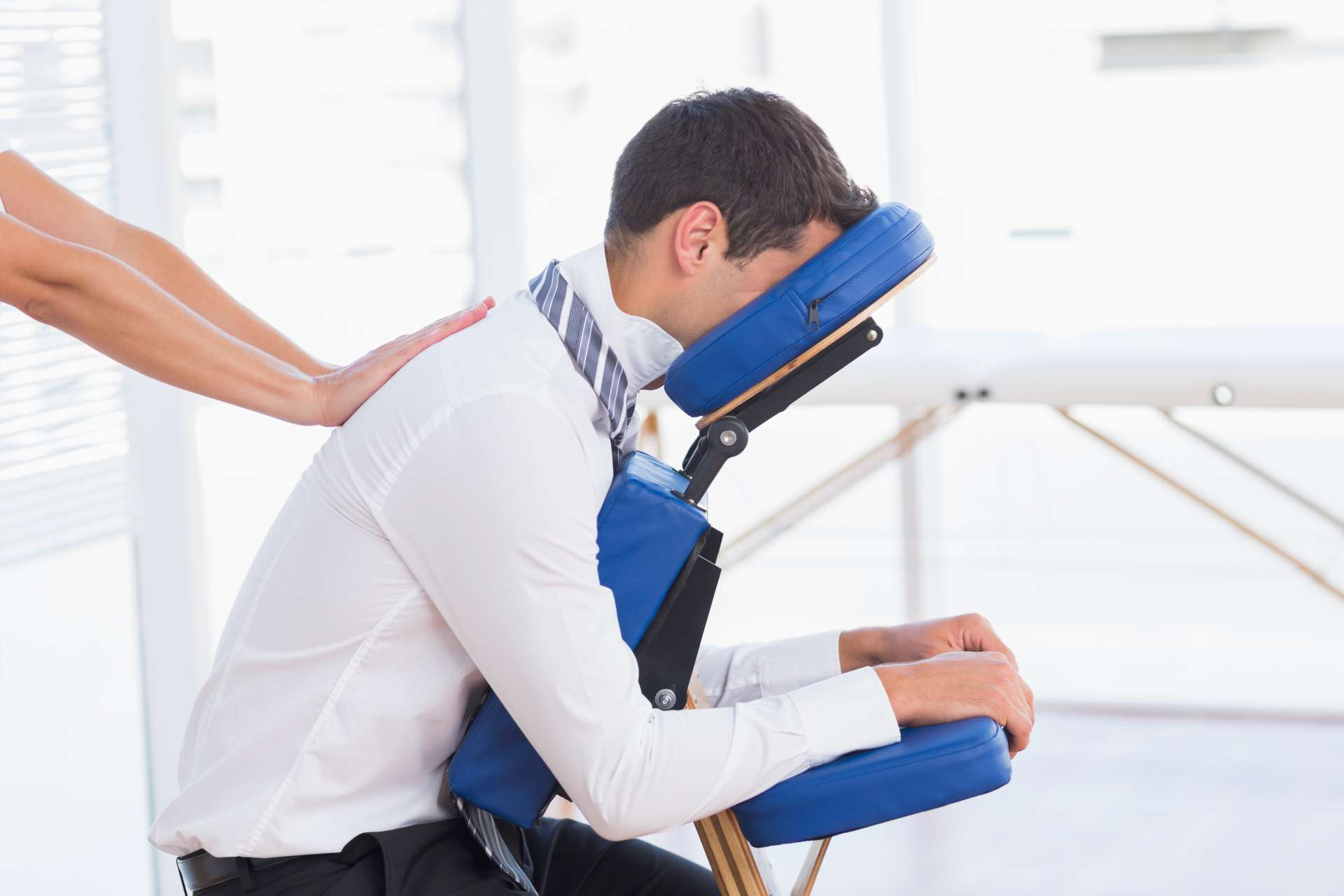 Man getting massage in office chair